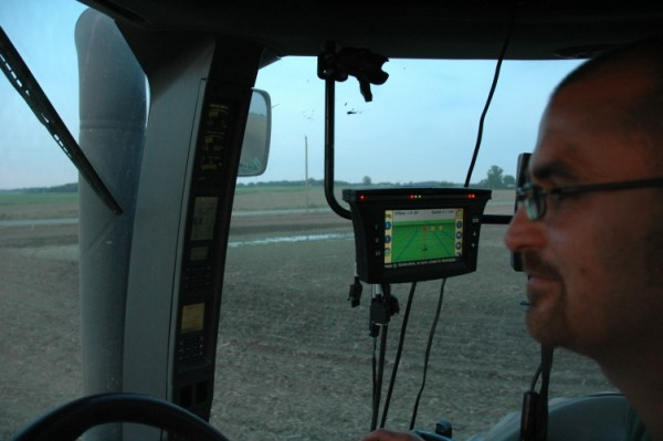 GPS monitor in enclosed cab tractor