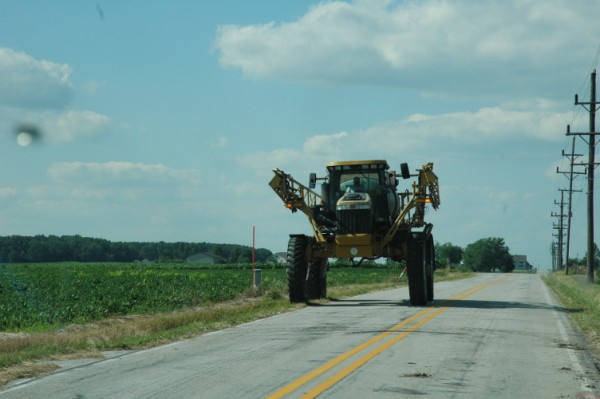 Crop sprayer on hard top road